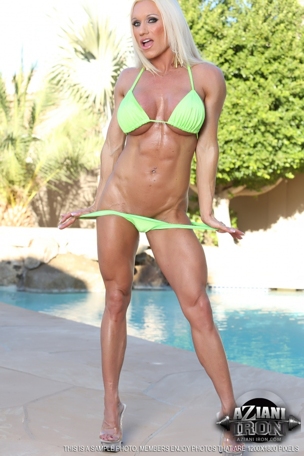 Female bodybuilder shows off her mature fbb muscles 8
