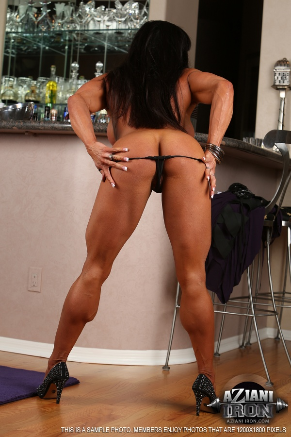 Female bodybuilder continues her leg and pussy workout 1